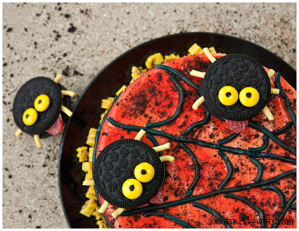 oreo spiders and twizzler spider web cake 6