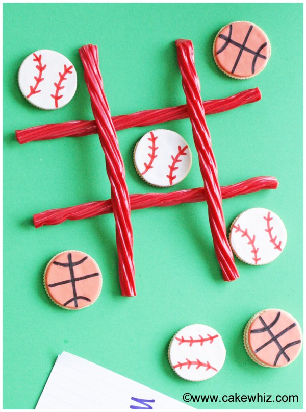 Sports ball cookies for a game of tic tac toe