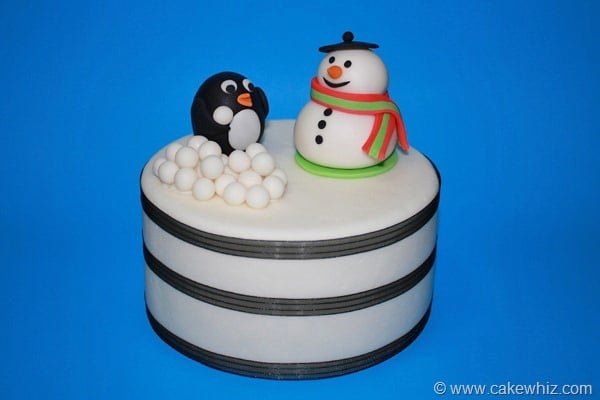 snowman and penguin cake