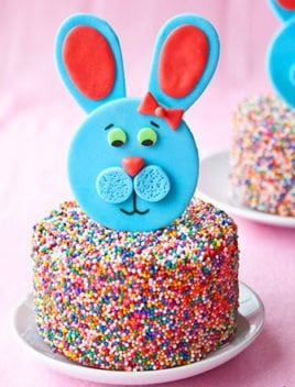 Easy Fondant Bunny Cake Topper on Sprinkle Cake Placed on White Plate