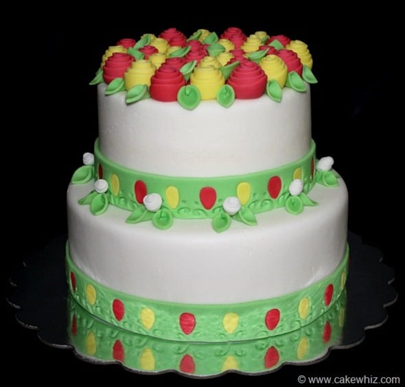 Decorated White Cake With Easy Fondant Roses Without Tools on Black Background