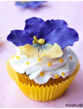 Easy Homemade Fondant Flower Cupcakes with Yellow Liner and Pink Background