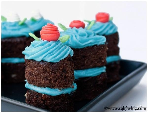 Mini Fondant Flowers on Mini Chocolate Cakes in Black Plate