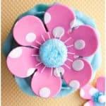 Polka Dot Pink Fondant Flower Cake on Yellow Background- Overhead Shot