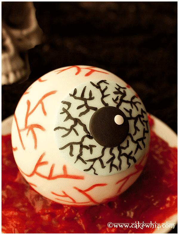 Creepy Eyeball Cake on Plate With Red Jam