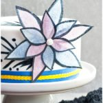 Edible Easy Wafer Paper Flowers on White Fondant Cake With Gray Background