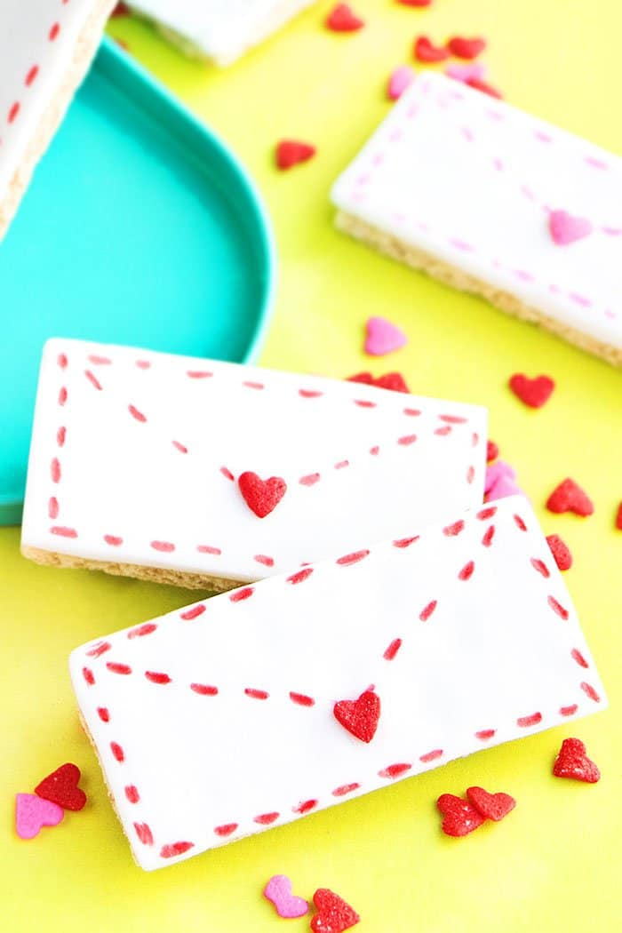 Easy Valentine's Day Cookies (Love Letter Cookies) Placed on Yellow Paper with Heart Sprinkles