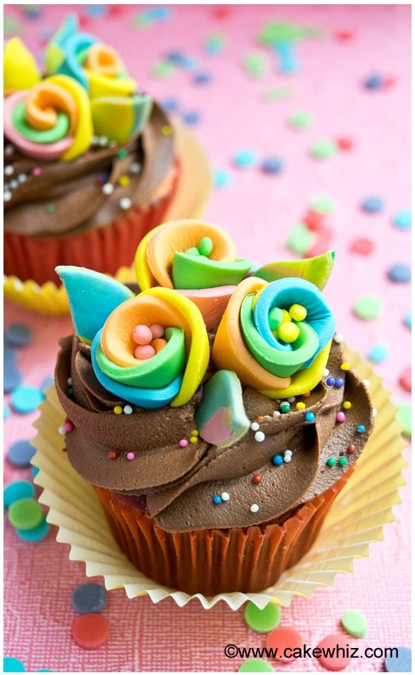 Colorful Fondant Flowers on Chocolate Cupcakes with Chocolate Frosting
