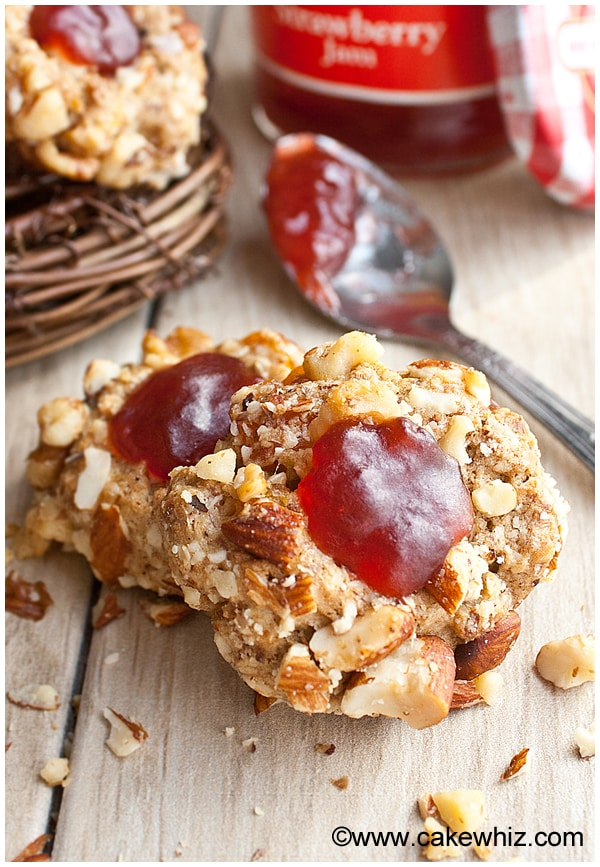 To make these peanut butter and jelly thumbprint cookies, you will ...