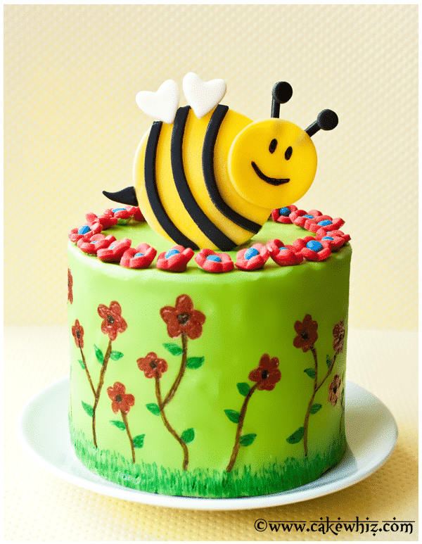 spring cake with flowers and bumblebee