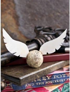 Edible DIY Harry Potter Golden Snitch Truffles on Stack of Books