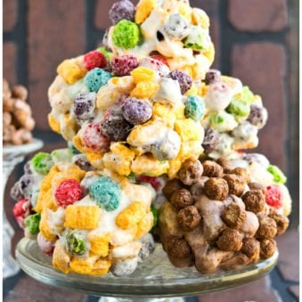 Stack of Easy Homemade Rainbow Cereal Balls on Glass Cake Stand