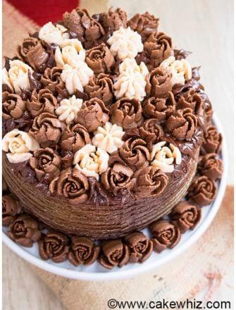 Easy Homemade Chocolate Buttercream Flowers Cake on White Cake Stand