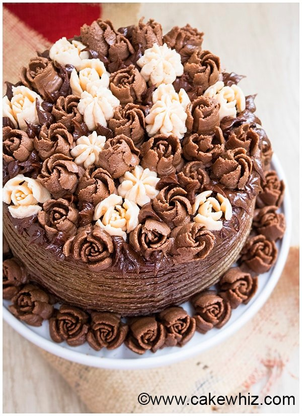 Chocolate Buttercream Flower Cake on White Cake Stand