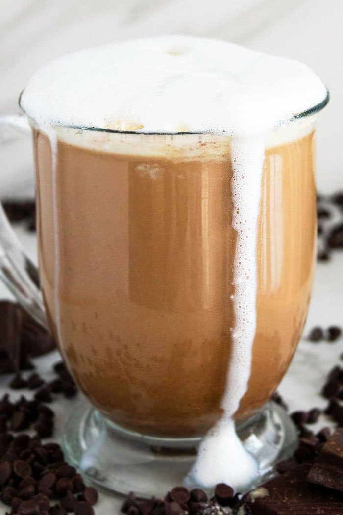 Homemade Mocha Latte with Milk Foam Dripping on the Side of Mug