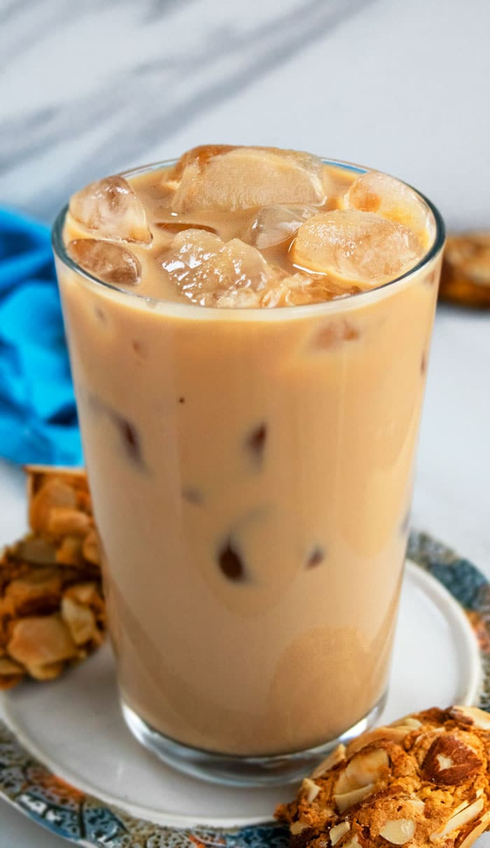 Iced Vanilla Latte in a Clear Glass on a Plate with Cookies