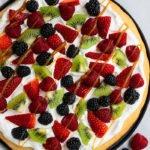 Easy Sugar Cookie Fruit Pizza on Black Plate