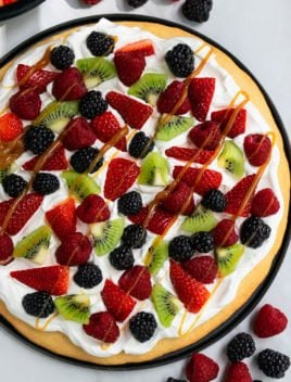 Easy Sugar Cookie Fruit Pizza on Black Plate