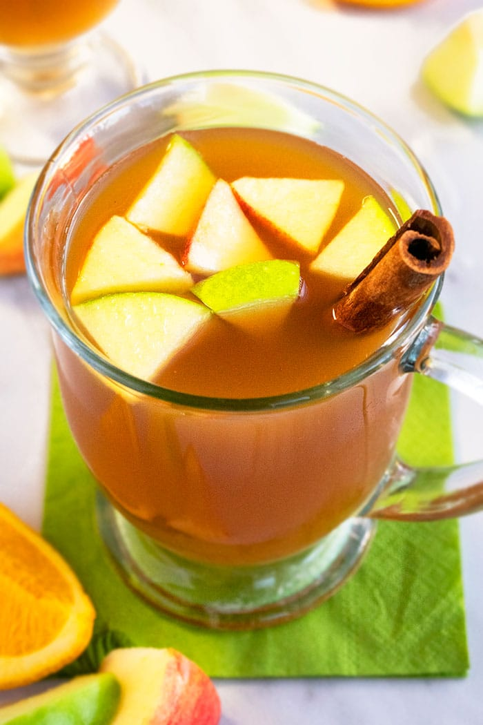 Overhead Shot of Homemade Apple Cider in Clear Cup on White Background
