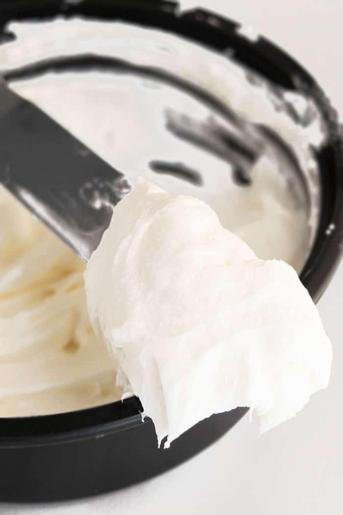 Closeup Shot of Spatula With Homemade Cinnamon Roll Icing