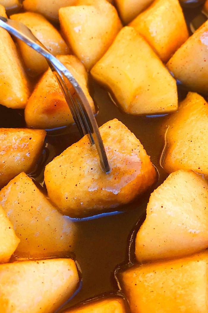 Diced Sauteed Apples on a Fork in Cinnamon Sugar Sauce