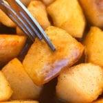 Closeup Shot of Homemade Cinnamon Apples on a Fork