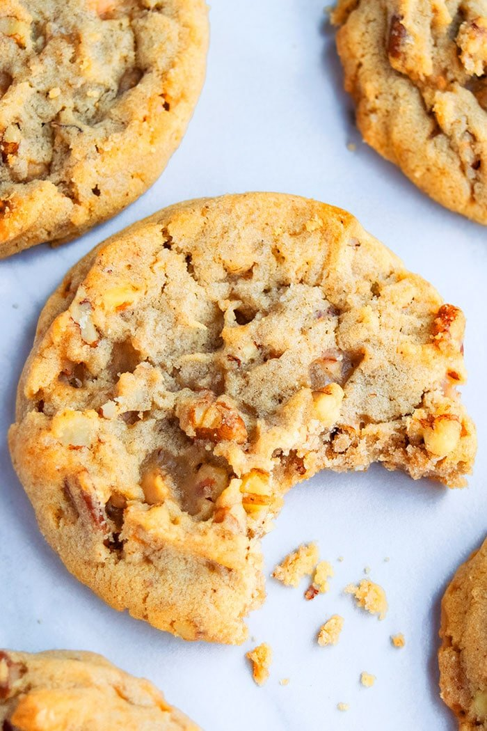 Soft and Chewy Pecan Cookies with Bite Removed