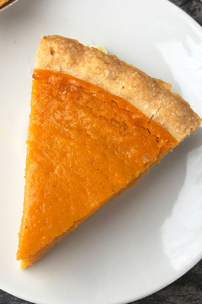 Slice of Best Sweet Potato Pie on White Plate