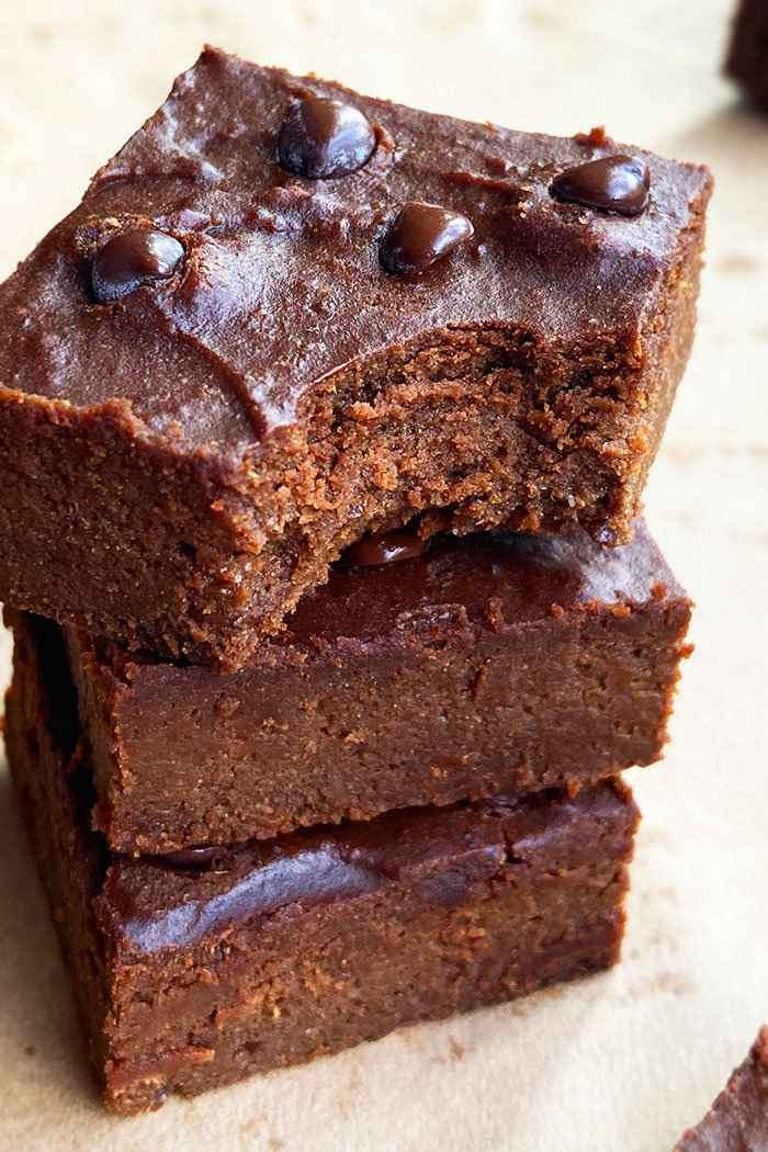Stack of Homemade Pumpkin Brownies With a Partial Bite Removed