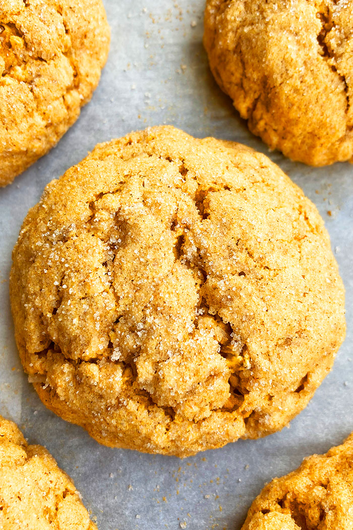 Closeup Shot of Homemade Pumpkin Spice Cookies on White Parchment Paper
