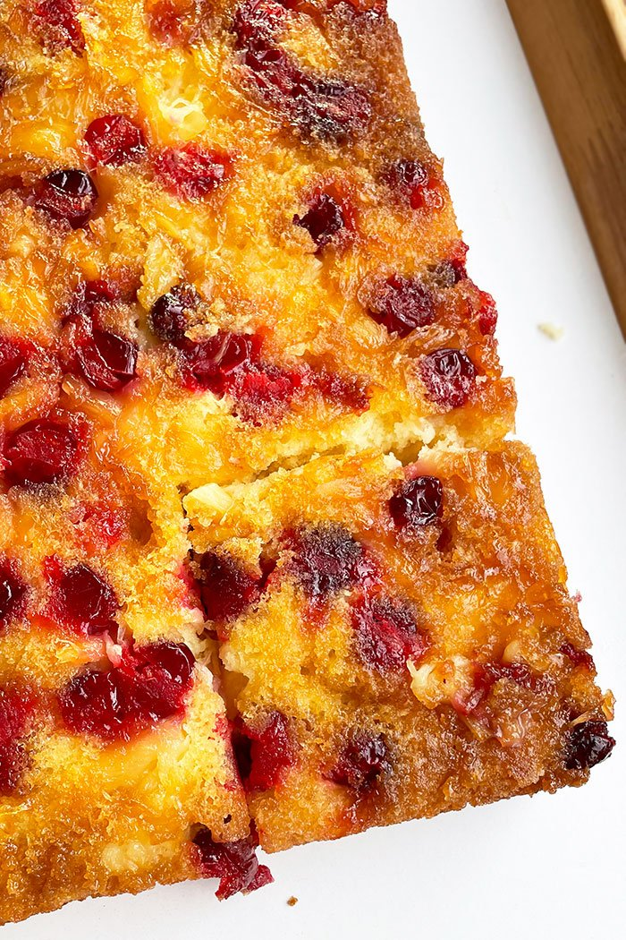 Cranberry Upside Down Cake With A Slice Cut Out