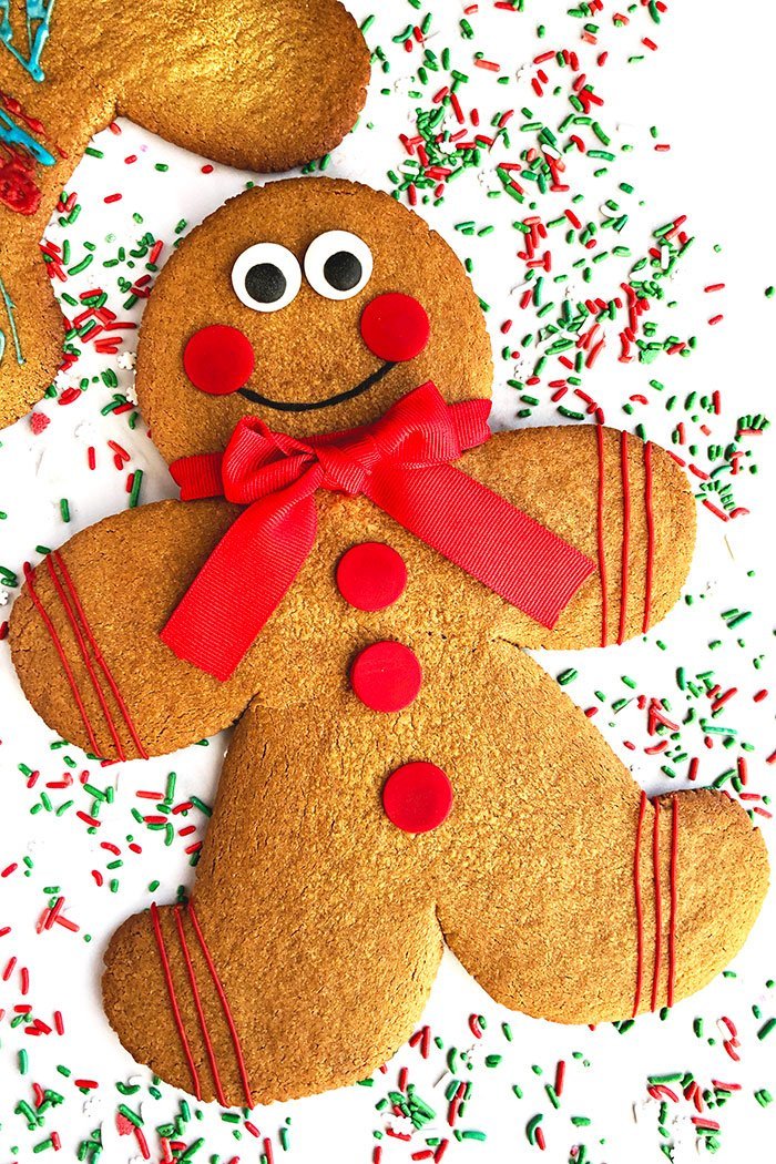 Jumbo Gingerbread Men Cookies on White Background With Sprinkles Scattered Everywhere