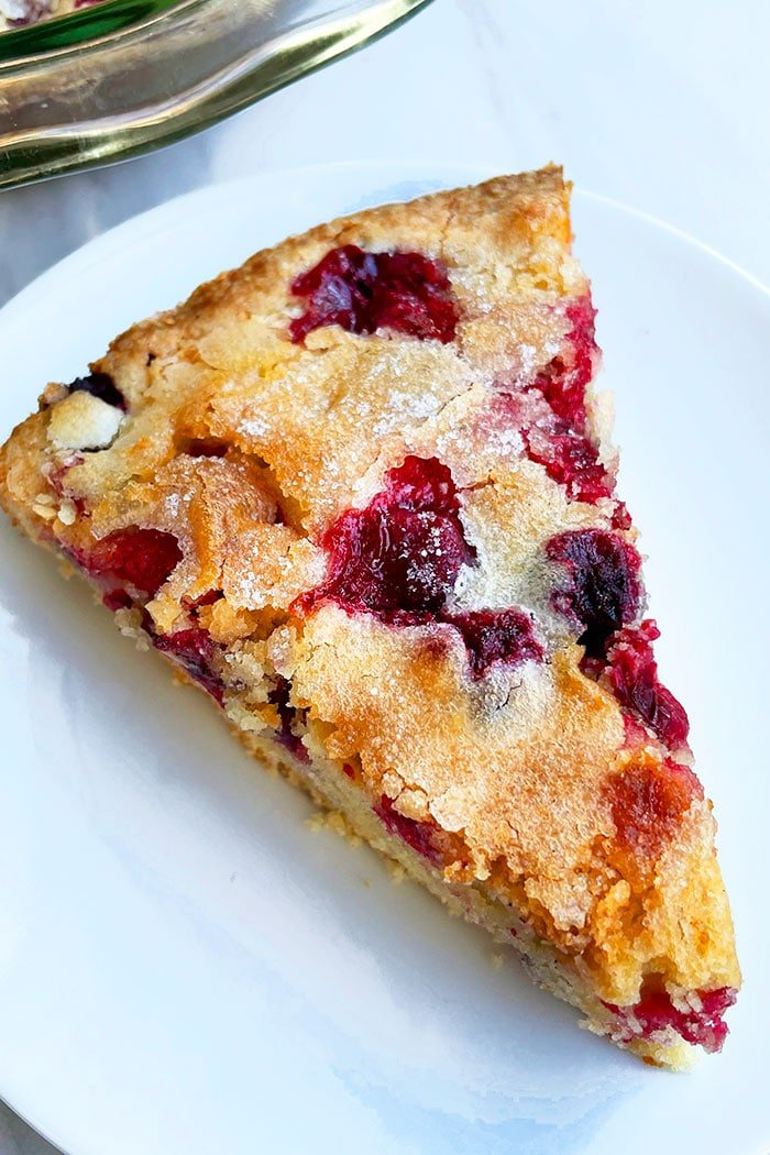 Slice of Crustless Holiday Pie With Fresh Cranberries  in White Plate