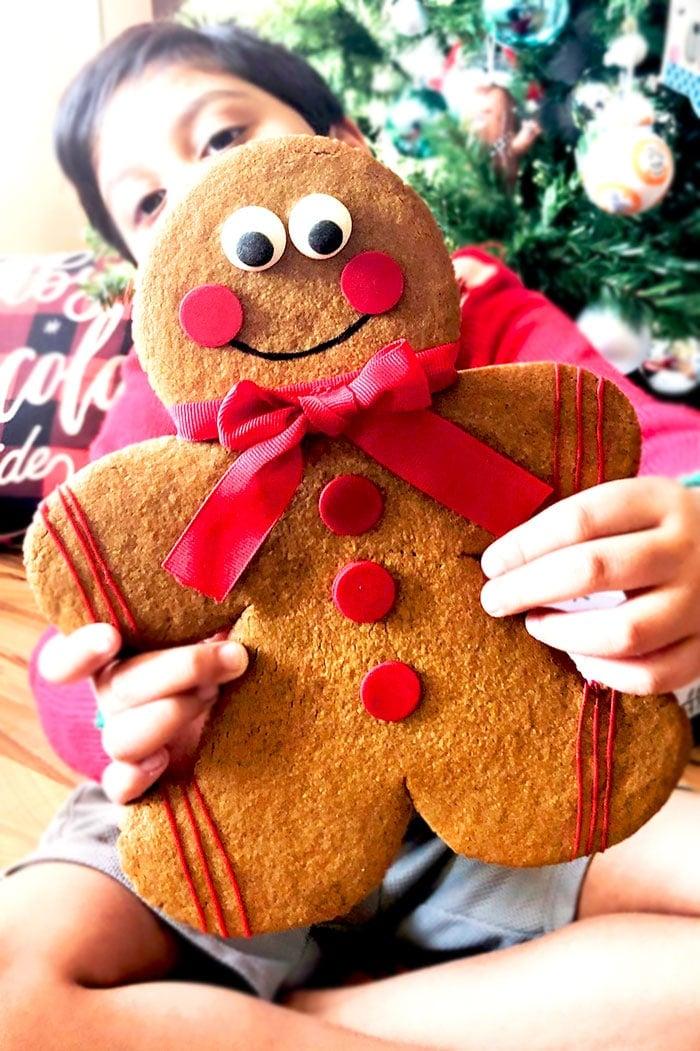 Kid Holding Jumbo Gingerbread Man Cookie