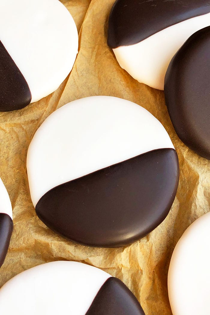 Closeup Shot of Single NYC Black & White Cookie On Brown Paper