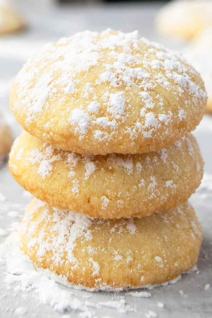 Stack of Easy Homemade Cream Cheese Cookies on Parchment Paper