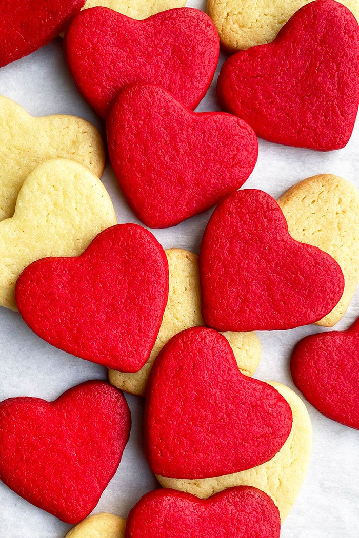 Overhead Shot of Cake Mix Heart Cookies on White Parchment Paper