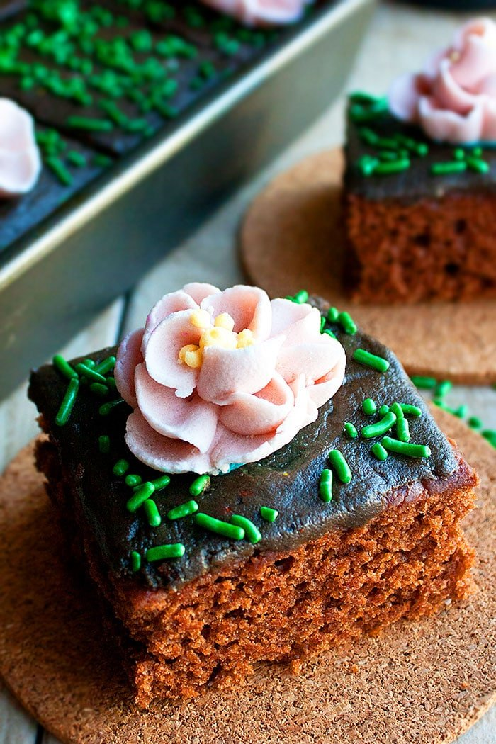 Chocolate Cake Decorated with Easy Pink Royal Icing Flowers and Green Sprinkles