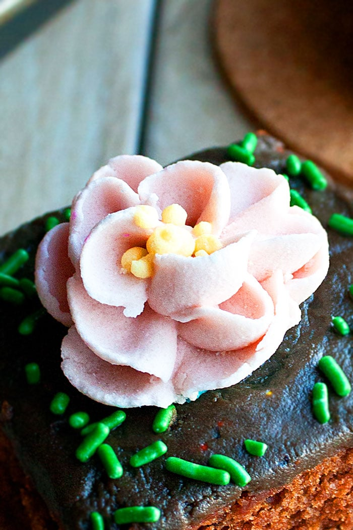 Closeup Shot of Pink Edible Sugar Flower on Top of Chocolate Cake