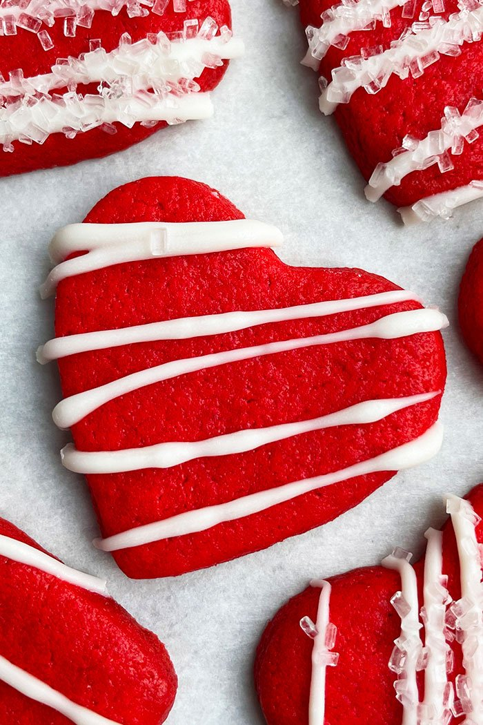 Cut Out Love Heart Sugar Cookies on White Parchment Paper