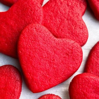 Easy Valentine's Day Red Heart Cookies With Cake Mix on White Parchment Paper