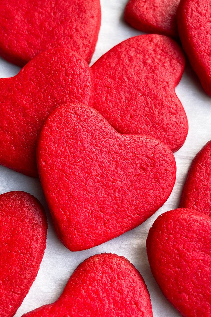 Red Velvet Heart Cookies Placed on Sheet of Parchment Paper