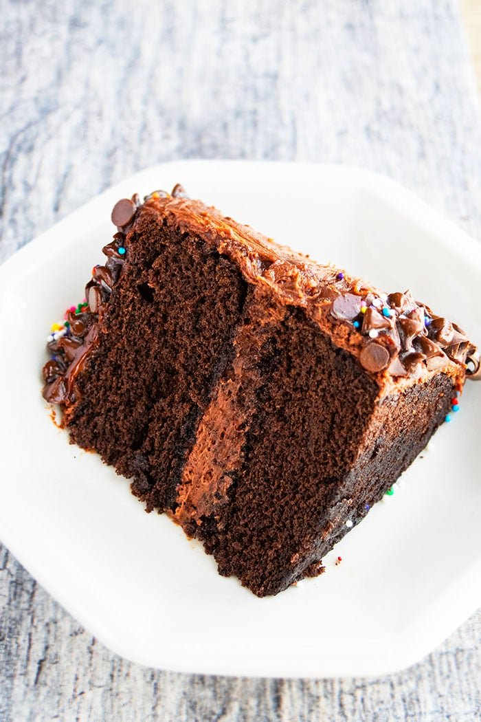 Slice of Best Chocolate Layer Cake on White Plate