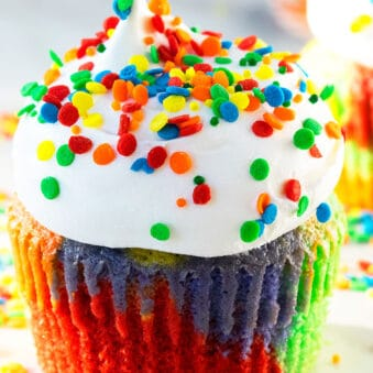 Easy Rainbow Cupcakes With Cake Mix Decorated with Whipped Cream and Colorful Sprinkles