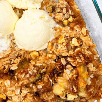Easy Homemade Banana Crumble in Glass Dish with Scoops of Vanilla Ice Cream