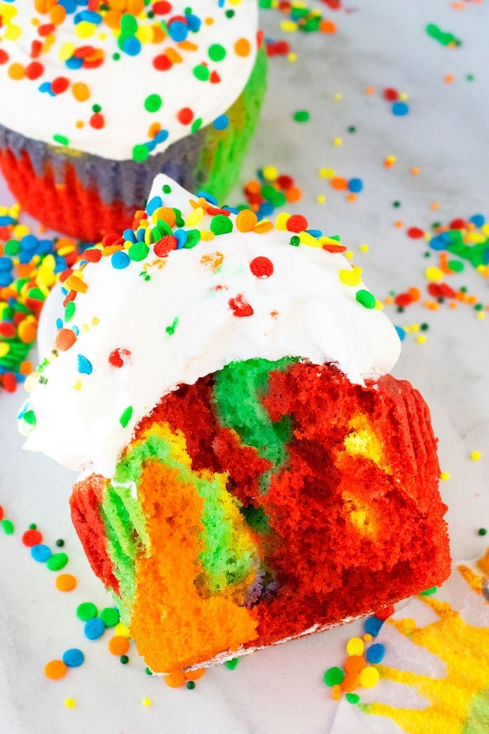 Partially Eaten Colorful Cupcake on White Background