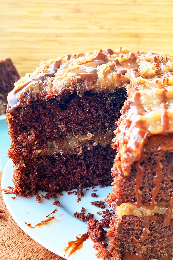 Closeup Shot of German Cake with Coconut Pecan Frosting With a Slice Removed
