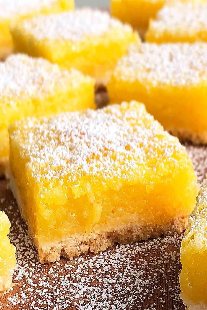 Closeup Shot of Dessert Bar Composed of Shortbread Cookie Crust and Lemon Curd Filling