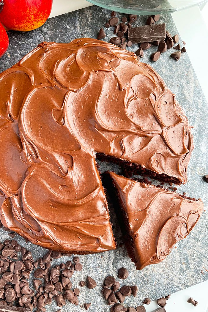 Homemade Eggless Chocolate Cake with Vegan Chocolate Frosting on Rustic Gray Background