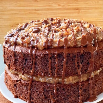 Easy Homemade German Chocolate Cake on White Plate With Wood Background